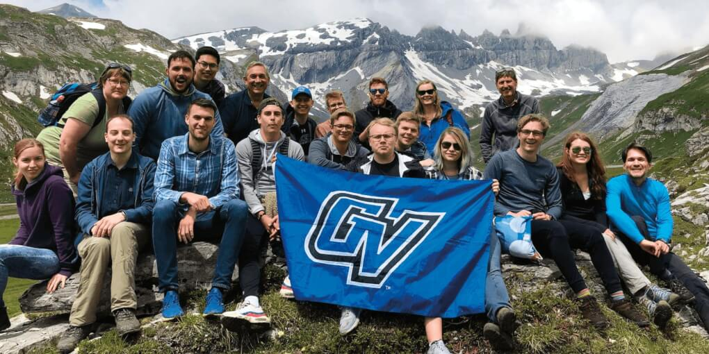group of people at Swiss Alps holding a GV flag